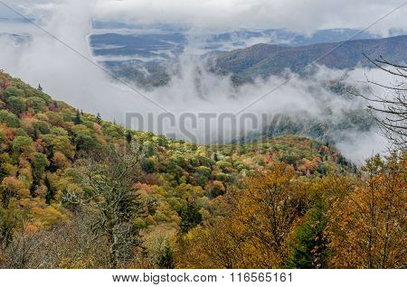 Fog Drops Into Mountains In Early Fall