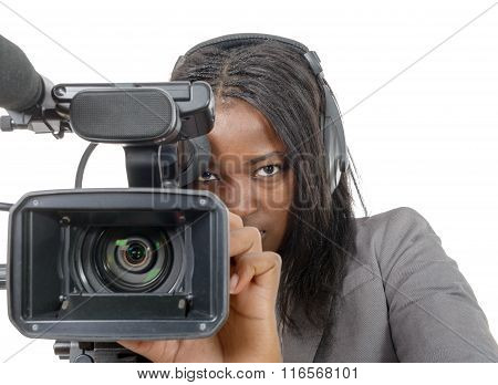 Young African American Women With Professional Video Camera And Headphone