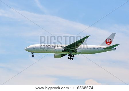 HONG KONG - JUNE 04, 2015: JAL aircraft landing at Hong Kong airport. Japan Airlines Co., Ltd (JAL) is the flag carrier airline of Japan and the second largest in the country behind All Nippon Airways