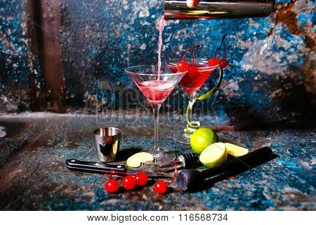 Bartender Preparing Cranberry Juice And Vodka - Cosmopolitan Alcoholic Cocktail
