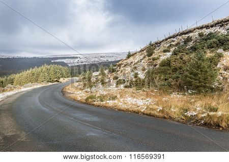 Winding Road Through Snowy White Landscape In Wicklow Gap