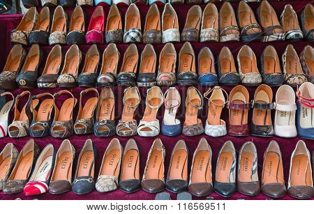 ISTANBUL - MAY 3: Faked shoes on sale on the narrow street around Grand Bazaar on Mal 3, 2015 in Istanbul, Turkey. Area around Grand Bazaar is well known seeling place for replica shoes,bags and jeans