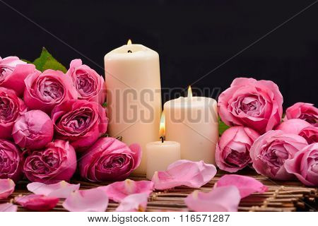Set of rose with candle ,oil and petals on mat