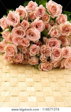 bouquet rose on dry leaf mat background