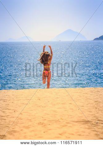Blonde Slim Girl In Bikini Runs From Sea On Sand Laughs