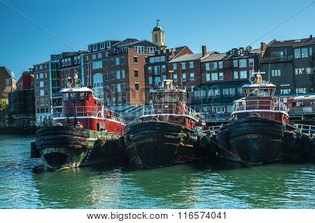 Portsmouth, ME USA - October 6 2015: A small fleet of tugboats is moored in the harbor in Portsmouth New Hampshire.