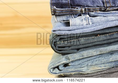 Stack Of The  Jeans On Wood Background