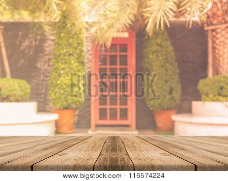 Wooden Board Empty Table blur building - can be used for display or montage your products.
