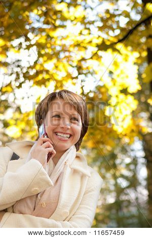 charming young woman with mobile phone