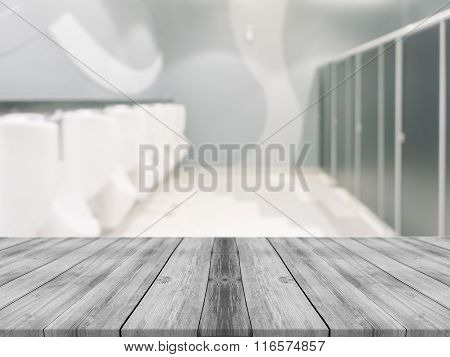Wooden Board Empty Table blur men toilet in restaurant. - can be used for display or montage.