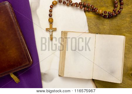 Ancient Book With Catholic Cross