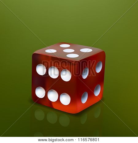 Red dice cube on green background
