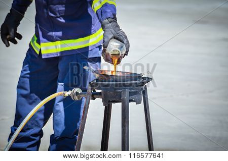 Fire Trainer Teach Pouring Oil Into Pan Flames For Conflagration Preventive Extinguish, Safety Conce