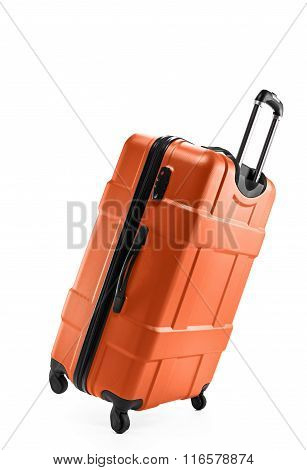 Orange color suitcase plastic on two wheels