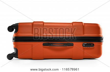 Orange color suitcase. lying horizontally