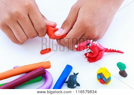 Child Molding Modeling Clay, On White Background. Strengthen The Imagination
