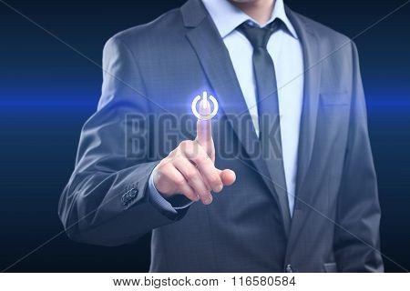 Businessman pressing power button concept