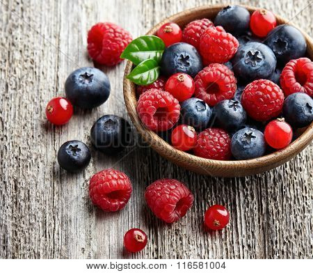 Fresh berries in closeup on a wooden background