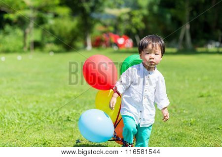 Little boy play with balloon