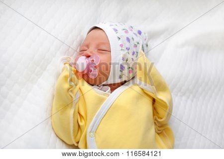 Newborn Baby Sucking A Pacifier