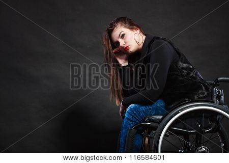 Sad Woman Sitting On Wheelchair