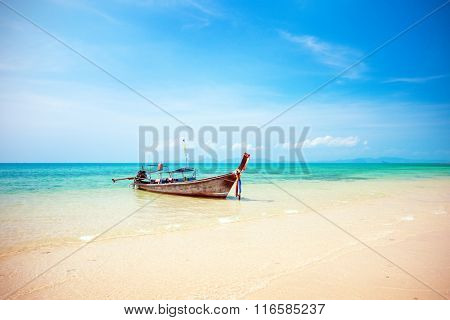 longtail boat and beautiful beach