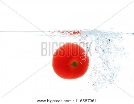 tomato falling or dipping in water with splash