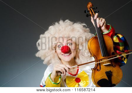 Clown in funny concept on dark background