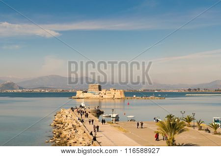 Athens, Greece, 27 December 2015. Life at Nafplio in Greece with the old castle bourtzi and the sky