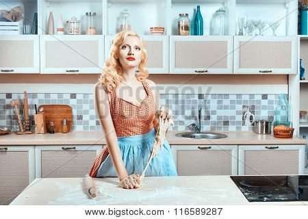 Girl Kneads Dough In The Kitchen And Dreams.