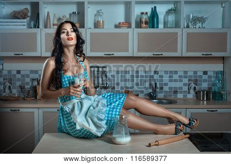 Girl Is Holding A Glass Of Milk.
