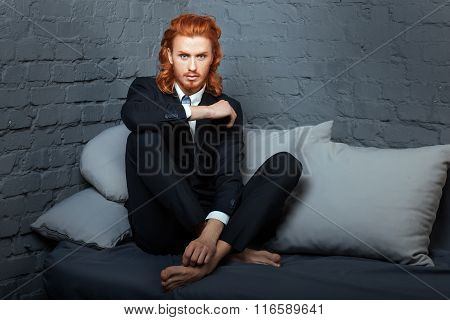 Guy With  Red Hair And Beard, Sitting On The Sofa.