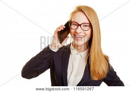 Smiling blond businesswoman calling with her smartphone