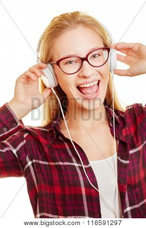 Woman with headphones listening to music and singing