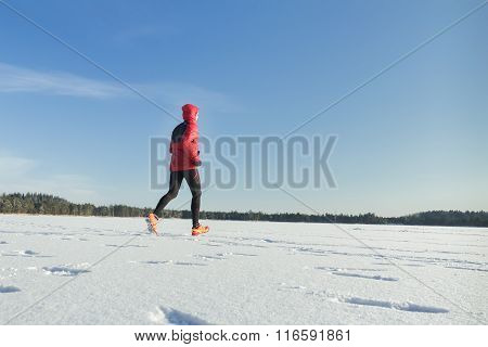 Trail running sport race of young man in winter outdoor