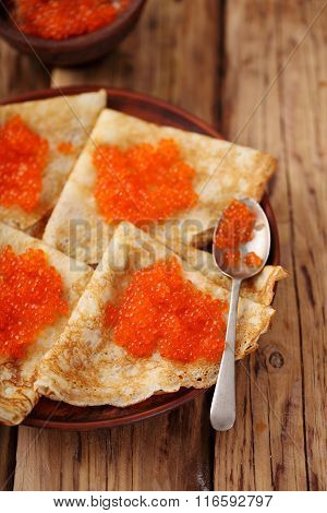 Pancakes with red caviar for Shrovetide