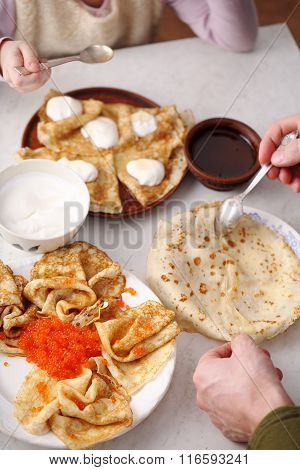 people eat pancakes, hands close-up