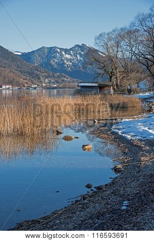 Idyllic Lake Shore With Boathouse, At The End Of Winter, Tegernsee