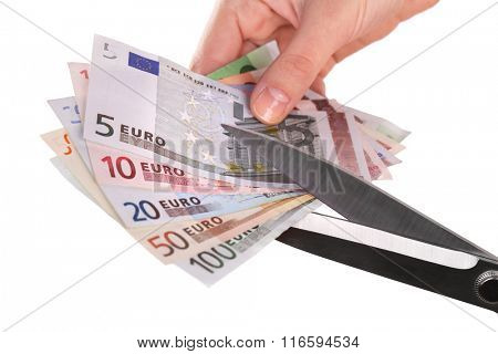Hands with scissors cutting Euro banknotes, isolated on white