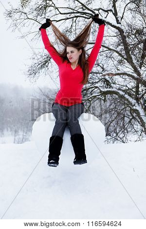 woman sitting on the heart of the snow