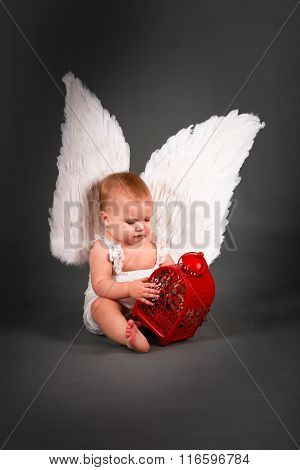 Baby Kid In White Dress With Angel Wings