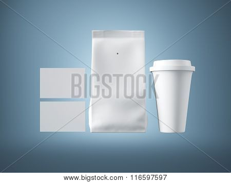 Set of paper package, coffee cup and two blank business cards.  Blue background. 3d render