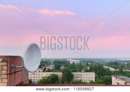 Satelite Dish And Residential Area And Beautiful Pink Sky During Evening
