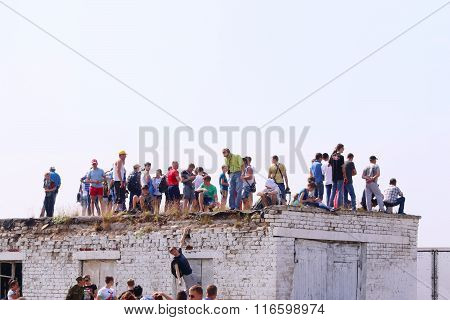Perm, Russia - Jun 27, 2015: Spectators On Roof On Airshow Wings Of Parma
