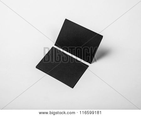 Black business cards on a white background. Identity design, corporate templates, company style. Hor