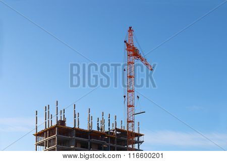 Big Stationary Hoist And Building Under Construction At Winter Day With Blue Sky