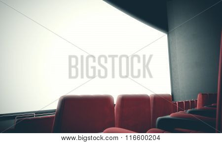 Closeup of empty cinema screen with red seats. With color filter. 3d render