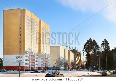 Street With Residential Buildings And Cars On Road At Winter In Perm, Russia. Text On Sign Kirovogra