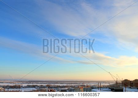 Frozen River And Panoramic View, Roof Of Tall Building And Sky At Cold Winter Evening
