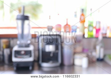 Abstract Blurred Photo Of Coffee Bar With Colored Bottle Glucose Syrup.